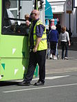 Southern Vectis staff directing buses at Cowes Co-op.JPG
