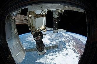 Soyuz TMA-11M - Soyuz TMA-11M docked at the ISS (center)