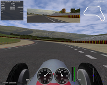 The cockpit of a racing car, with various 2D dynamic instruments displaying speed, rpm, fuel left, damage, G-Forces, clutch situation, a mini-map, the number of frames per second, a rear mirror, lap times and driver information.