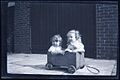 Squeeeeeze - who needs an Xbox anyway? Two kids in a tiny wooden cart, ca 1930 (11151466286).jpg