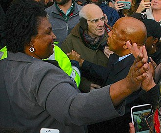 Stacey Abrams - Abrams with John Lewis in 2017