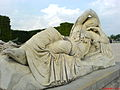 Statue of resting woman from the garden of Versailles.JPG
