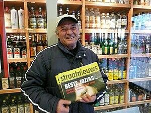 Street newspaper - A vendor for Straatnieuws in Zoetermeer, the Netherlands