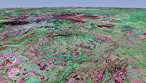 Strangways crater - Oblique false colour Landsat image draped over digital elevation model (x10 vertical exaggeration), Strangways crater; screen capture from NASA World Wind