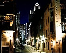 Narrow Montreal street at night