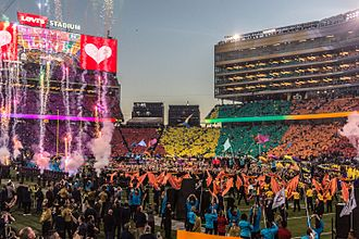 Super Bowl 50 halftime show - Field during the halftime show. The audience participates in a card stunt