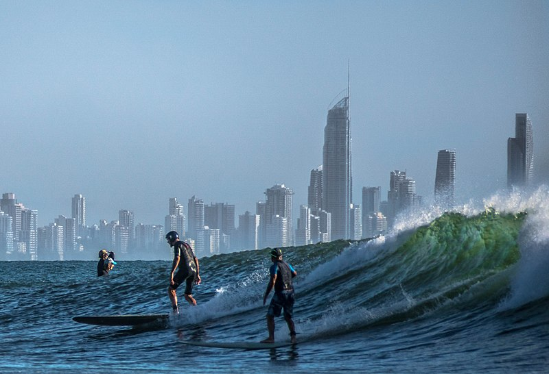 surfers with city back drop where there are many businesses for sale in Gold Coast