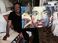 TV news anchor, author, artist John Johnson with one of his paintings.jpg