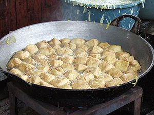 Tahu goreng - Tofu being fried in Indonesia