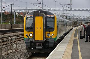 English: London Midland 350117 arrives at Tamw...