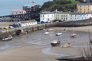 Tenby Lifeboat Station - The empty Tenby harbour at low-tide with views towards the lifeboat stations, which still have direct water access into the sea