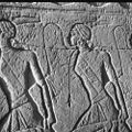 The Battle of Kadesh, a group of prisonners at he feet of one of the colossuses at the entrance to the Great Temple.jpg