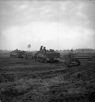 8th Infantry Brigade (United Kingdom) - Universal Carriers and 6-pdr anti-tank guns of the 1st Battalion, South Lancashire Regiment during the advance on Venraij, 17 October 1944.