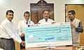 The CMD, National Seeds Corporation Limited, Shri V.K. Gaur presenting the dividend cheque for the year 2014-15 to the Union Minister for Agriculture and Farmers Welfare, Shri Radha Mohan Singh, in New Delhi November 05.jpg