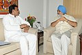 The Chief Minister of Uttar Pradesh, Shri Akhilesh Yadav meeting the Deputy Chairman, Planning Commission, Shri Montek Singh Ahluwalia for finalizing plan size for 2012-13 for the State, in New Delhi on July 18, 2012.jpg
