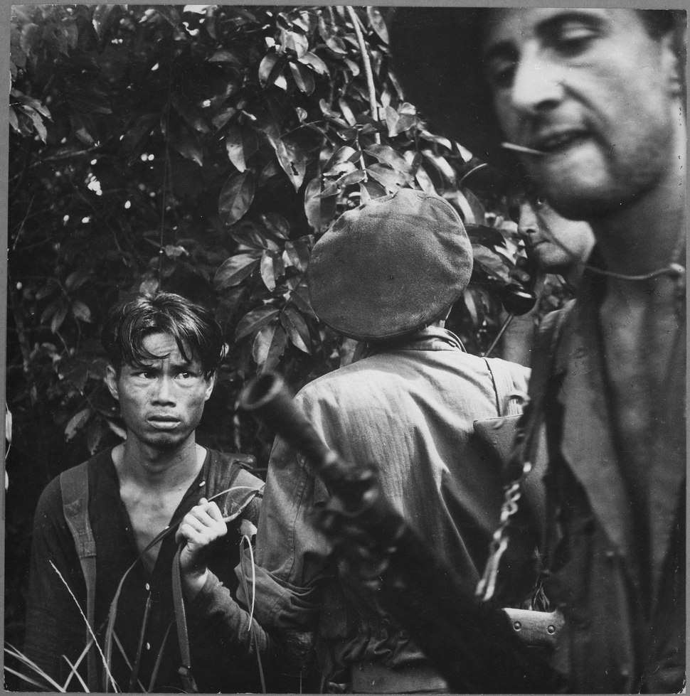 The French Foreign Legion is playing the major combat role in the war against the Vietminh. Here a red-suspect has been - NARA - 541969