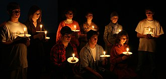 The Laramie Project - Scene from a 2008 performance depicting the candlelight vigils held for Matthew Shepard