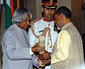 The President, Dr. A.P.J. Abdul Kalam presenting Padma Shri to Dr. Anil Prakash Joshi, for his contribution in promoting indigenous technologies, at investiture ceremony in New Delhi on March 29, 2006.jpg