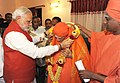 The Prime Minister, Shri Narendra Modi meeting Sri Shivakumar Swamy ji, during his visit to the Siddaganga Mutt, at Tumkur, in Karnataka on September 24, 2014.jpg