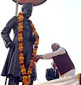 The Prime Minister, Shri Narendra Modi paying floral tributes at the statue of Pt. Madan Mohan Malavia, at Lanka Chauraha, in Varanasi, Uttar Pradesh on December 25, 2014.jpg