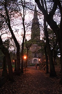 The western approach to St Cuthberts in Edinburgh, in the twilight.jpg