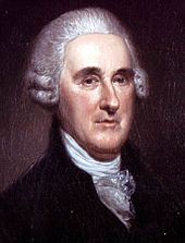Upper body of a well-dressed man with a large forehead wearing a powdered wig
