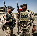 Two Iraqi soldiers aftermath of Third Battle of Fallujah.jpg