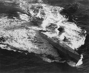 U-185 sinks after being hit by US depth charges