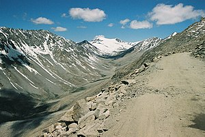 U-shaped valley - U-shaped valley in Leh valley, Ladakh, NW Indian Himalaya. The glacier visible at the head of the valley is the last remnants of the formerly much more extensive valley glacier which carved this valley.