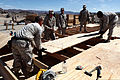 U.S. Marines with Engineer Company, Combat Logistics Regiment 2, 2nd Marine Logistics Group, build new south west asia (SWA) huts at their forward operations base (FOB) during Enhanced Mojave Viper (EMV), on 120910-M-KS710-003.jpg
