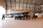 U.S. Marines with Marine Attack Squadron (VMA) 211 replace the wings of an AV-8B Harrier II aircraft at Camp Bastion in Helmand province, Afghanistan, Sept 120903-M-EF955-026.jpg