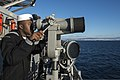 U.S. Navy Seaman Recruit Martin Miles stands lookout watch aboard the guided missile cruiser USS Philippine Sea (CG 58) as it moors in Piraeus, Greece, for a scheduled liberty port visit March 4, 2014 140304-N-PJ969-117.jpg
