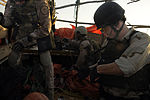 U.S. Navy Sonar Technician 2nd Class Roger Byassee and other members of USS Chosin's (CG 65) visit, board, search and seizure team and a Coast Guard maritime safety and security team search a dhow in the Gulf 100101-N-GQ684-199.jpg