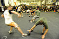 U.S. Sailors and Marine compete in a game of dodge ball during a Moral, Welfare and Recreation fun day in the hangar bay of amphibious assault ship USS Makin Island (LHD 8) in the Philippine Sea Dec. 11, 2011 111211-N-EK905-203.jpg