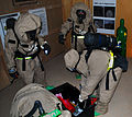 U.S. Soldiers and Marines check a leaking canister while in chemical suits during joint chemical warfare training at Camp Buehring, Kuwait, Sept 090903-A-PT935-129.jpg