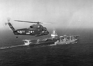 UH-2B over USS Enterprise (CVAN-65) and USS Virgo (AE-30) 1966.jpeg