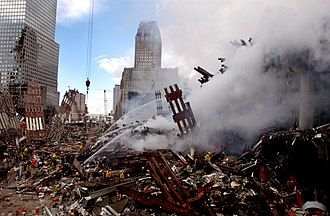 Aftermath of the September 11 attacks - Fires burned amidst the rubble of the World Trade Center for weeks after the attack.