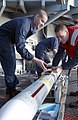 US Navy 030207-N-4965F-506 Fire Controlman 3rd Class Perez Figueroa and Fire Controlman 3rd Class William Nassau prepare to load a NATO Sea Sparrow missile into a launcher aboard the nuclear powered aircraft carrier USS Theodor.jpg