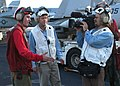 US Navy 030317-N-6817C-002 An Aviation Ordnanceman is interviewed by the British Broadcasting Corporation (BBC) about the capabilities of missiles and bombs prepared for air wing aircraft on the flight deck of the aircraft car.jpg