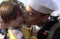 US Navy 031105-N-2143T-001 A Nimitz sailor greets his family after arriving home aboard USS Nimitz (CVN 68).jpg