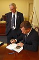 US Navy 031118-N-2568S-005 Best-selling author James Bradley signs a copy of his book for Secretary of the Navy Gordon R. England.jpg