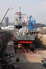 US Navy 040316-N-2101W-013 The guided missile cruiser USS Cowpens (CG 63) at the completion of its Ships Repair Force (SRF) dry dock period in Yokosuka, Japan.jpg
