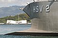 US Navy 040707-N-3228G-009 The bow of High Speed Vessel Two HSV-2 Swift frames the USS Arizona Memorial while shifting berths in Pearl Harbor, Hawaii.jpg