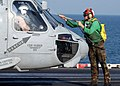 US Navy 041210-N-6363M-020 Aviation Electronics Technician 3rd Class Michael Yorkovitch washes the windscreen of an SH-60F Seahawk before flight.jpg