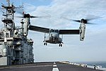 "US Navy 050323-N-7945K-116 An MV-22 Osprey, assigned to the ""Argonauts"" of Marine Tiltrotor Operational Test and Evaluation Squadron Two Two (VMX-22), prepares to land on the flight deck aboard the amphibious assaul.jpg"