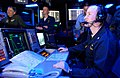 US Navy 050616-N-0000P-073 Commander, Carrier Strike Group Five (CSG-5), Rear Adm. Jamie D. Kelly, left, and personnel monitor computer screens in the Combat Direction Center aboard USS Kitty Hawk (CV 63).jpg