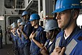US Navy 050626-N-7945K-003 Boatswain's Mate 2nd Class Nicholas Lamere, right, stands by with the rest of a detail preparing for a replenishment at sea.jpg