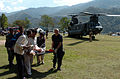 US Navy 051012-N-8796S-260 Members of the Pakistan military and civilians from multinational relief agencies carry an injured woman to a U.S. Army UH-60 Blackhawk helicopter for a medical evacuation in the remote Pakistani vill.jpg