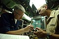 US Navy 051025-N-9288T-112 Electronics Technician 1st Class Jay Miller, left, and Chief Electronics Technician Erick Encarnacion work on an assembly piece for the Stern Plane Angle Indicator.jpg