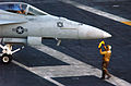 US Navy 060226-N-4776G-055 A pilot assigned to the Fighting Redcocks of Strike Fighter Squadron Two Two (VFA-22) is directed into launch position on the flight deck aboard the Nimitz-class aircraft carrier USS Ronald Reagan (CV.jpg